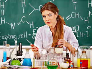 Chemistry teacher at classroom.