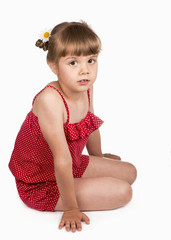 Portrait of a little blond girl above white background