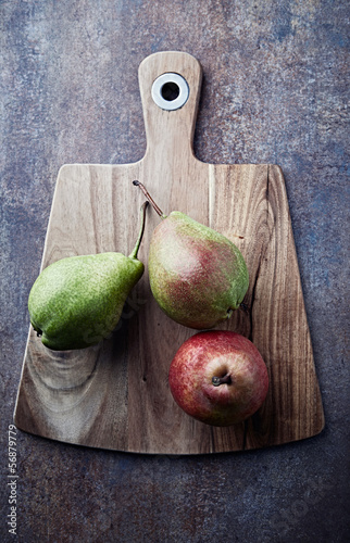 Still life with pears on a kitchen board