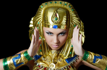 The girl-dancer in a costume of the Pharaoh