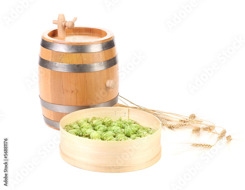 Barrel and sieve with hop.