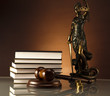 Statue of Lady Justice, gavel and books, gold coins