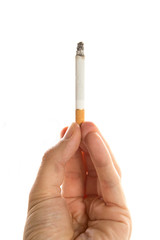 Male hand holding a cigarette on white background