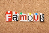 The word Famous on a cork notice board