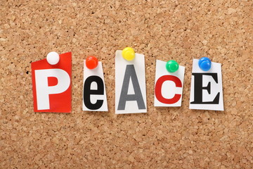 The word Peace on a cork notice board