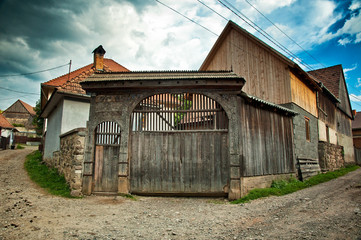 Traditional old wooden carved gate in Transylvania, Romania