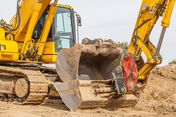 Construction site - excavator with removable bucket