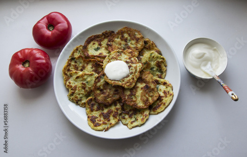 potato pancakes and tomatoes