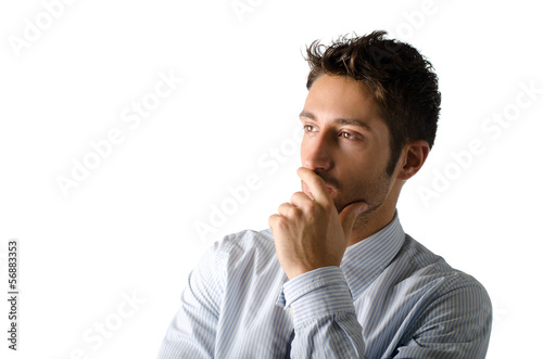 Handsome young businessman looking to a side, isolated