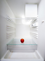 apple in an empty refrigerator