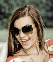 Young brunette with sunglasses
