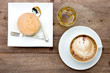 caramel custard cake and cup of coffee with tea on wood backgrou