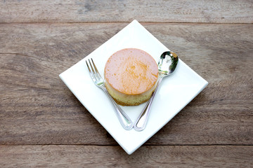 caramel custard cake on wood background
