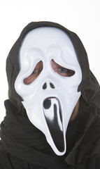 Woman wearing ghost mask at Halloween