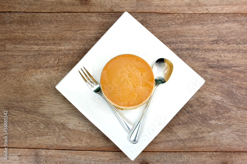 caramel custard cake on wood background2