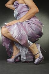 Woman wearing satin dress and heels