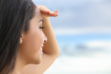 Close up of a beautiful woman looking at the horizon