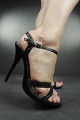 Woman feet wearing high heel shoes