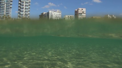 View of the beach from the sea. Underwater View.