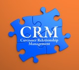 CRM on Blue Puzzle Pieces. Business Concept.