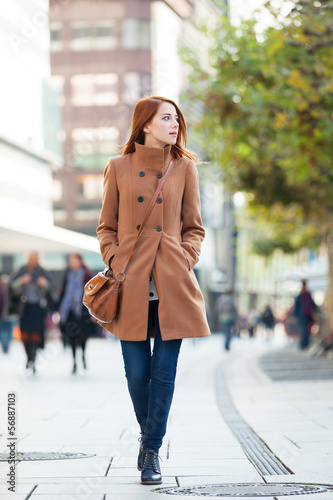 Redhead women walking on the street