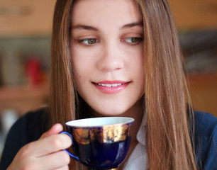 Girl with a cup of drink in hand