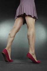 Woman wearing short dress and high heels