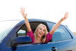Happy blonde girl driver in car window