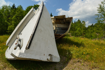 Abandoned and damaged wooden lobster boat