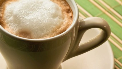 Close up of a foamy cappuccino coffee