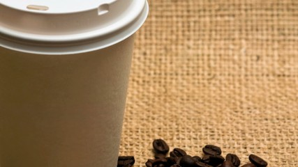 Disposable coffee cup and roasted coffee beans