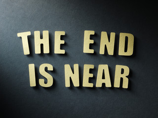 The word The End Is Near on paper background