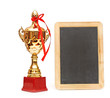 gold trophy cup with blank small blackboard isolated on white