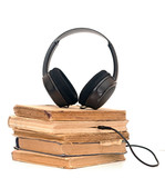 black headphones and book on a white background