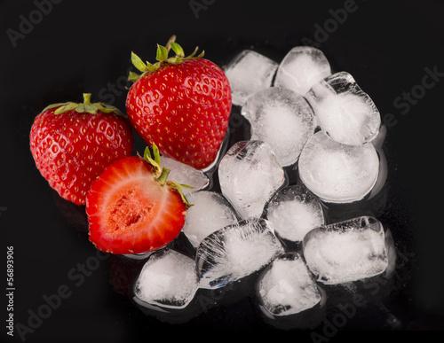 ice cubes, mint leaf, fresh strawberry on black