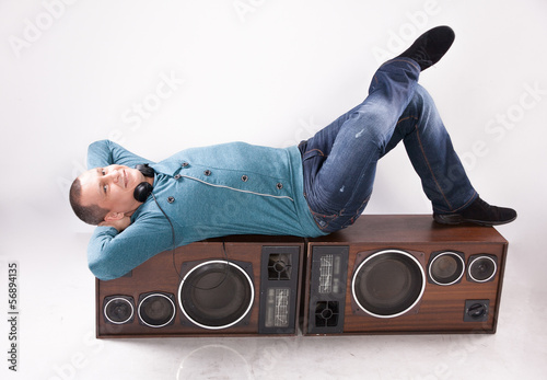 handsome dj lying on vintage loudspeaker