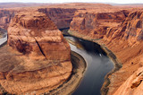 Two Boats Navigate Colorado River Deep Canyon Horseshoe Bend