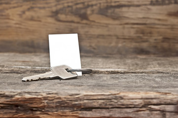 key with a blank label on an old wooden table