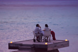 romantic couple have outdoor dinner