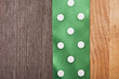 vintage wooden background with green polka-dot ribbon