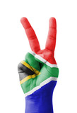 Hand making the V sign, South Africa flag painted