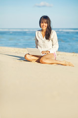 woman with laptop on a beach