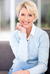 middle aged woman sitting at home