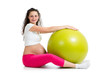 Pregnant woman excercises with fit ball