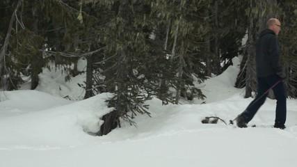 Man snow shoeing