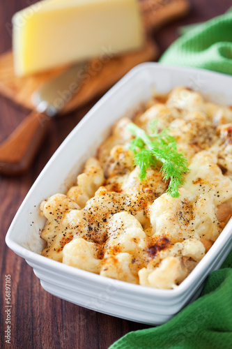 Gratin of fennel and cauliflower with cheese, selective focus