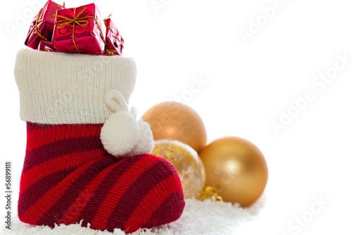 christmas stocking with decorations isolated on white