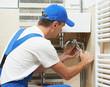 Leinwanddruck Bild - Young plumber man worker