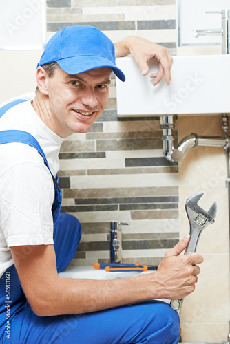 Young smiling plumber man worker