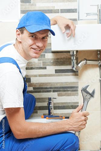Leinwanddruck Bild Young smiling plumber man worker